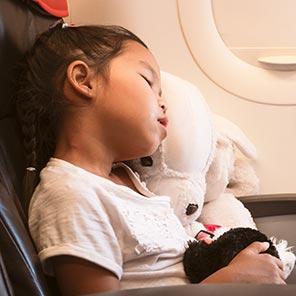Child asleep on an aeroplane
