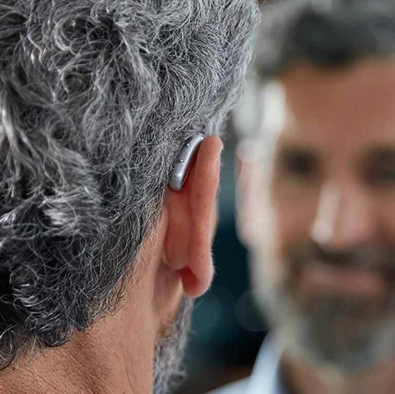 RIC hearing aid on mans ear